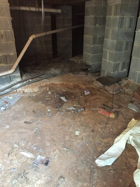 crawl space moisture and dirt under residential home