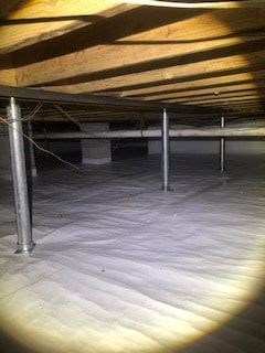 dark crawl space after being drained and encapsulated